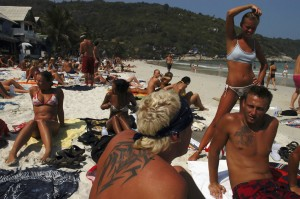 Holiday makers relax ahead of the start of the monthly full moon party.