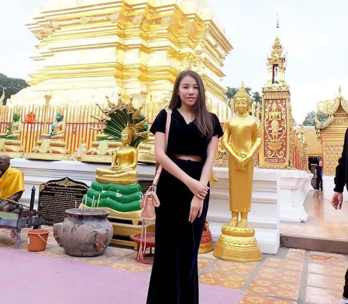 visiting temple in chiang mai with thai girl