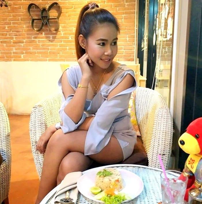sexy Thai girl having lunch